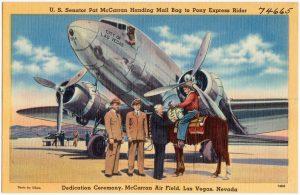 U.S._Senator_Pat_McCarran_handing_mail_bag_to_Pony_Express_rider,_Dedication_Ceremony,_McCarran_Air_Field,_Las_Vegas,_Nevada_(74665)